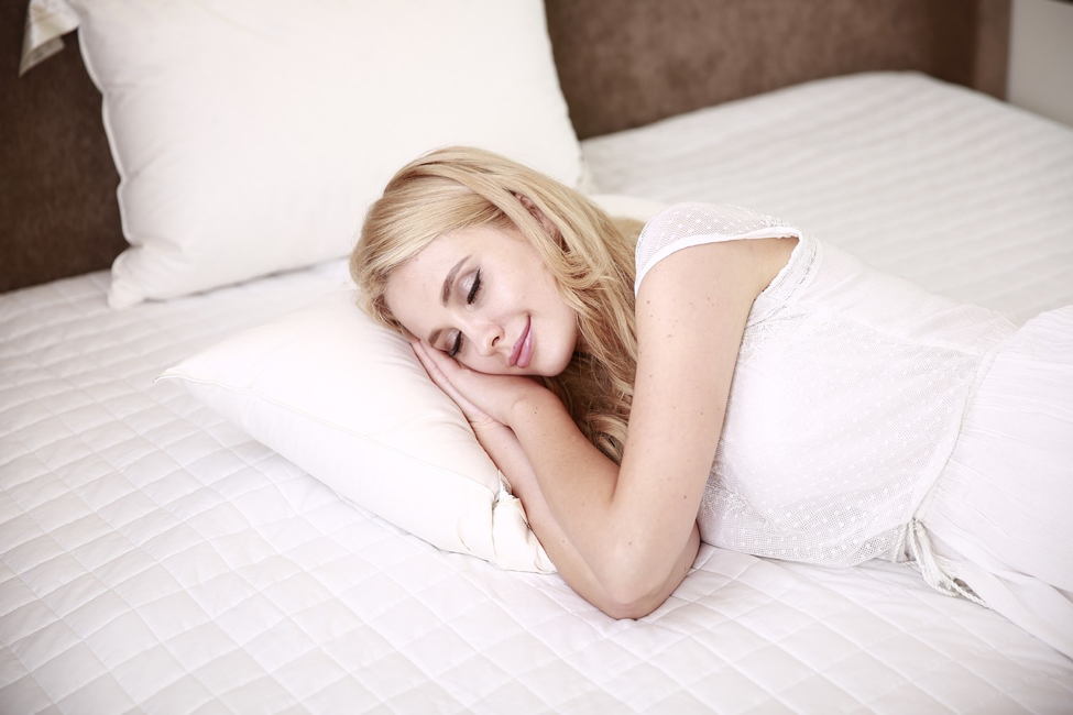 woman smiling in her sleep